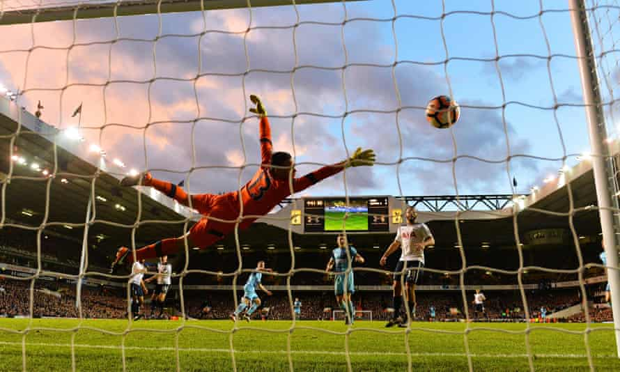 Gary Thompson puts Wycombe ahead at White Hart Lane.