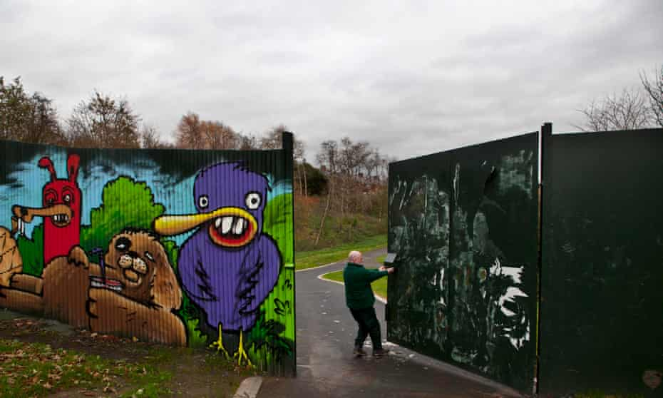 A employee closes the peace gate in Alexandra park at 3pm.