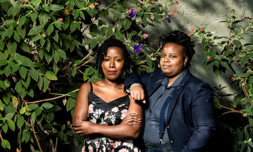 """Portrait of Amber Senter and Tsion """"Sunshine"""" Lencho (in floral dress) of the Supernova Women collective, an organisation for women of colour working in the cannabis industry. Photographed in front of Magnolia Dispensary in Oakland, CA, USA"""