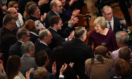 Theresa May leaves the auditorium after her speech.