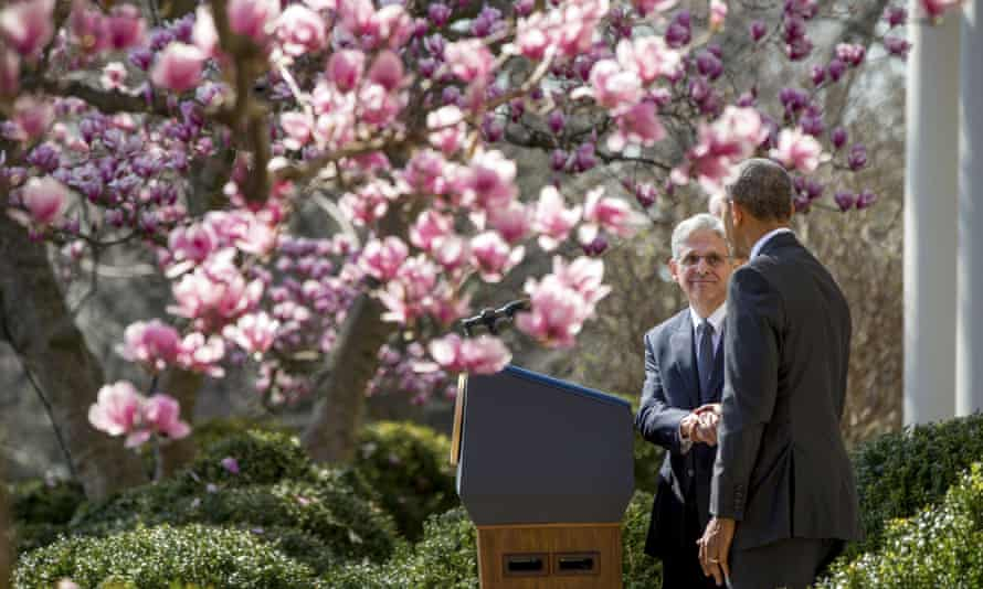 Federal appeals court judge Merrick Garland shakes hands with Barack Obama as he is introduced as his nominee for the supreme court.