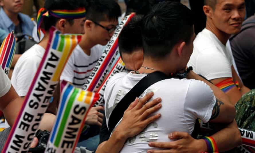 Supporters hug after Taiwan's constitutional court ruled that same-sex couples have the right to legally marry