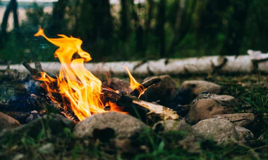 Summer campingWarm fire in the camp