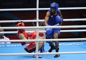 Nicola Adams wins the flyweight women's boxing gold medal by knocking down Ren Cancan