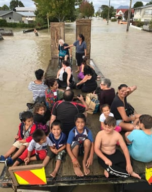 Children being evacuated from flooded Edgecombe, New Zealand, after Cyclone Debbie passed through.
