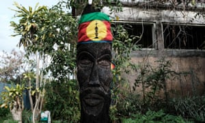 A flag of the Kanak and Socialist National Liberation Front hung around a sculpture in a former settlers' farm in New Caledonia