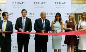 Donald Trump Jr, Eric Trump, Donald Trump, Melania Trump, Tiffany Trump and Ivanka Trump cut the ribbon at the new Trump International Hotel.