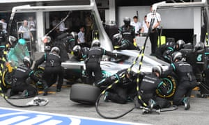 The pit crew get to work on Nico Rosberg's Mercedes.