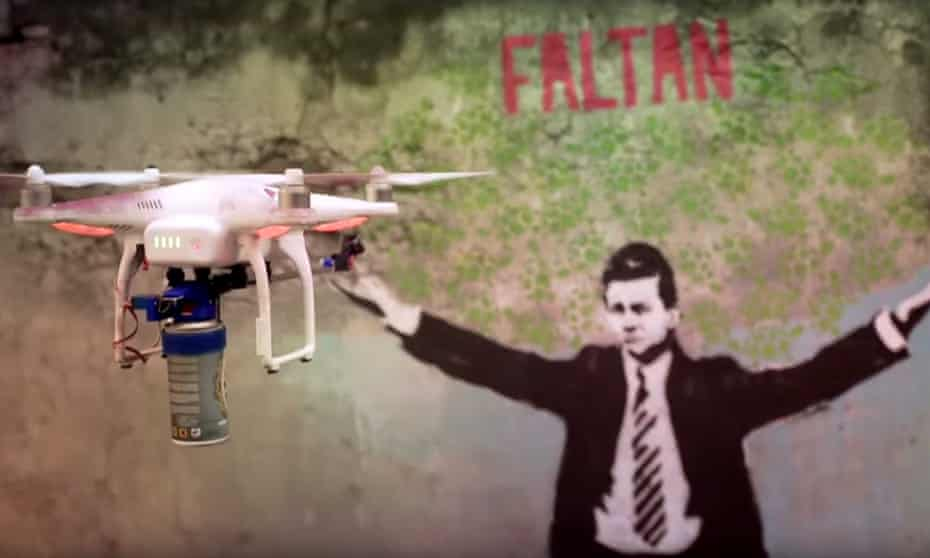 Droncita the graffiti drone prepares to deface a picture of the country's embattled president, Enrique Peña Nieto.