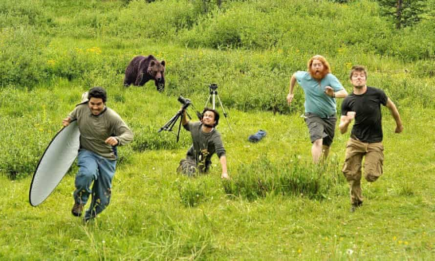 Fake photo of National Geographic photographers running from a bear.