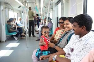 Passengers on board a Kothi Metro train
