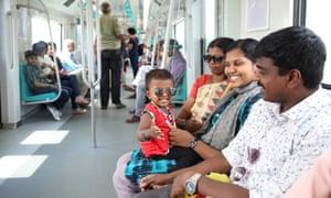 People travel on the Kochi metro in Kerala, India