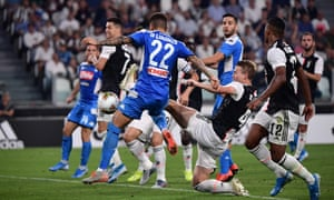 Napoli's Giovanni Di Lorenzo bundles the ball home to get the visitors back on level terms.