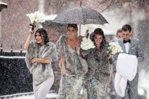 Philadelphia, PAA bridal party makes their way through a snowstorm in Philadelphia.