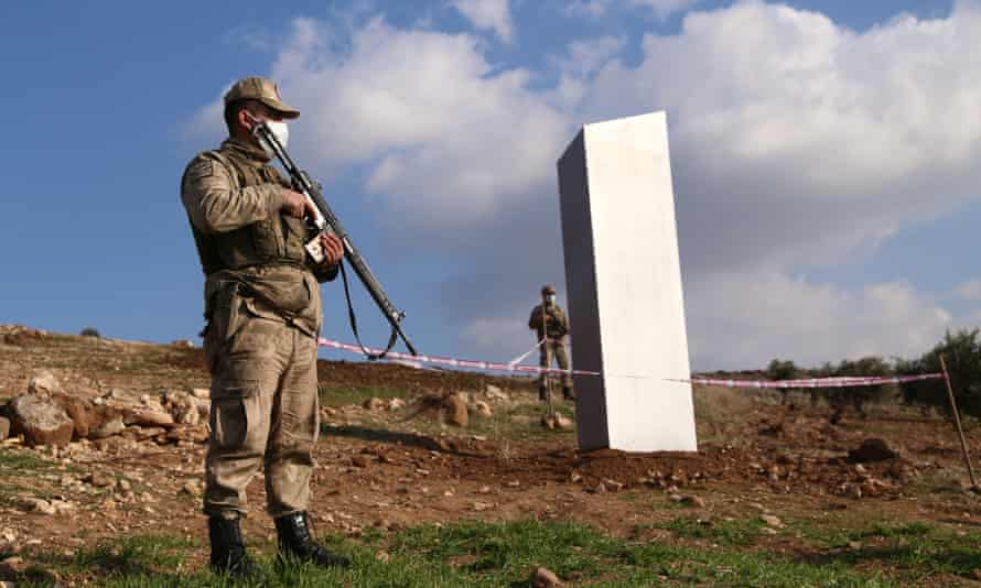 Soldiers stand guard near a mysterious metallic slab in south-east Turkey.