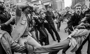 Press photographers capture the arrest of an anti-racist demonstrator