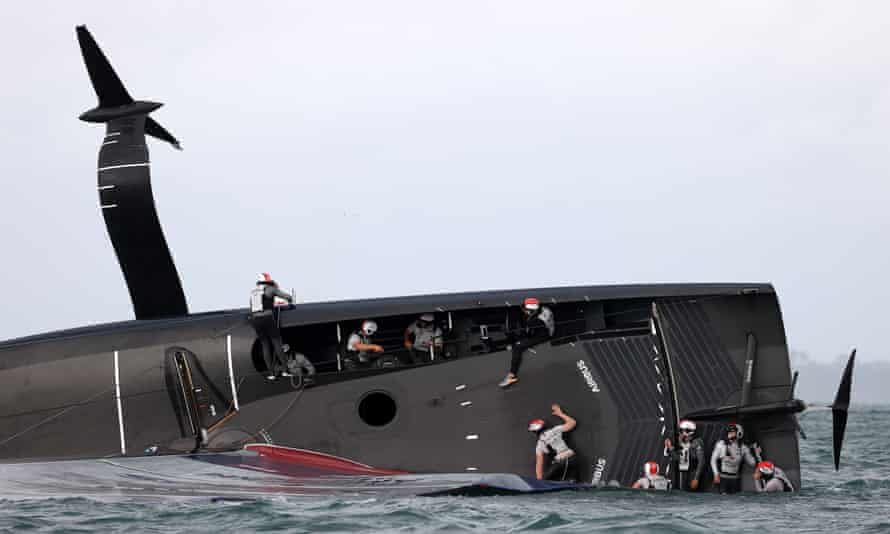 American Magic's boat 'Patriot' lies in Auckland's Waitemate Harbour after capsizing on the third day of racing of the America's Cup Challenger Series.