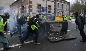 A protester holds a flare during an anti-government demonstration in Bourges.