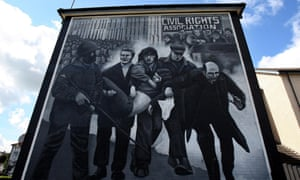 The mural in the Bogside area of Derry, depicting Daly waving a white handkerchief as he led Jackie Duddy away from danger on Bloody Sunday.