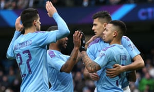 Gabriel Jesus celebrates with his teammates after Manchester City's third goal