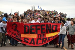 Native Americans march to a sacred burial ground disturbed by bulldozers building the Dakota Access Pipeline