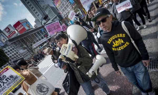 Protesters against Japan's refugee policy gather in Shibuya ward, Tokyo, in March 2016.