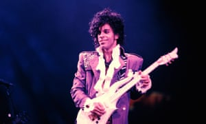 Prince performing on stage on the Purple Rain tour.