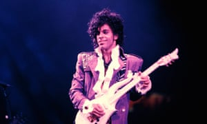 Prince performing on stage during the Purple Rain Tour in 1984.
