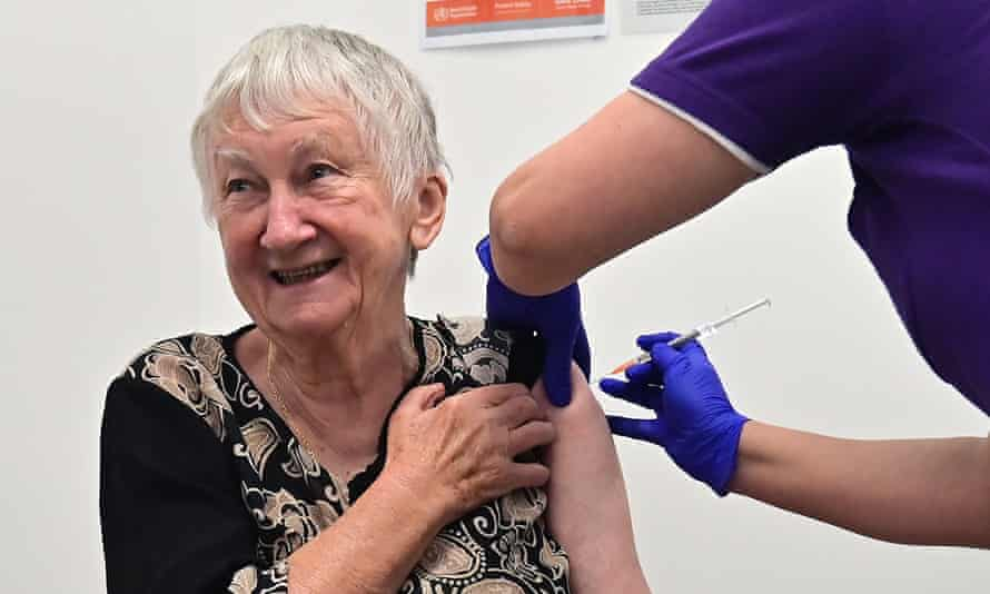 elderly woman receives covid vaccination