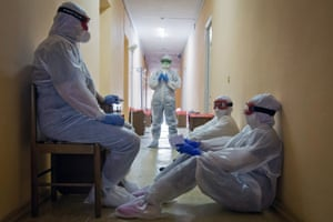 Yevpatoria, RussiaMedical workers wait in a corridor at the Priboi health resort, which has been repurposed as a hospital during the coronavirus pandemic