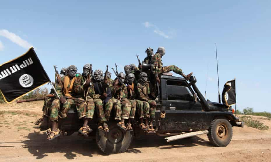 Members of al-Shabaab ride in a pick-up truck in Somalia. The group has been targeting Kenyans since 2011