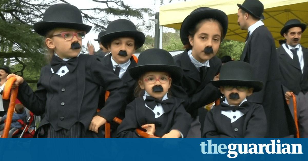 Charlie Chaplins gather in their hundreds to set world record – video