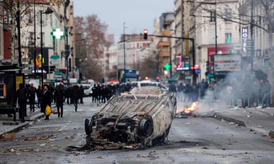 A car burns outside the Jean-Pierre Timbaud high school in Aubervilliers