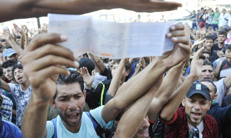 Refugees demonstrate at the closure of Keleti station in Budapest on Tuesday.