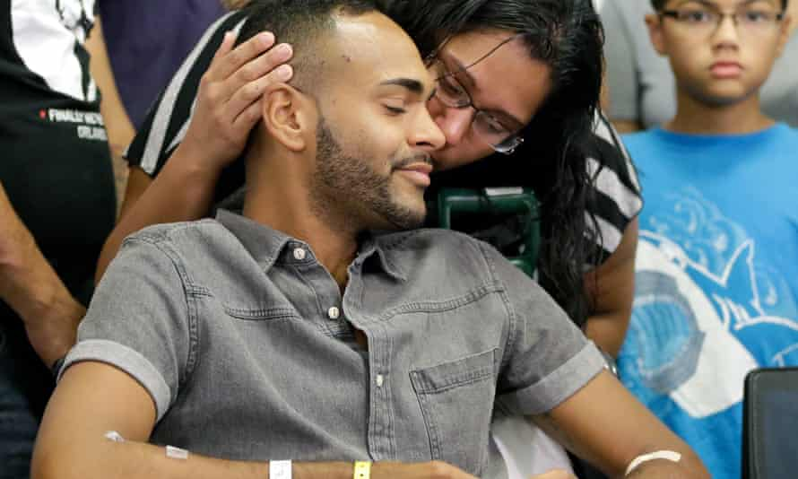 Angel Colon, left, is kissed by his sister at a news conference at the Orlando Regional Medical Center Tuesday.