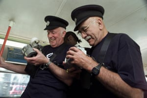 Celebrating the 40th anniversary of Amnesty International, actors Warren Mitchell and Richard Wilson become bus conductors on the number 38 route at Victoria station in London in 2005