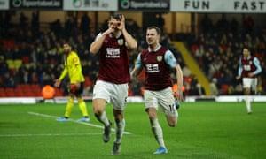 James Tarkowski celebrates scoring Burnley's third goal against Watford with teammate Ashley Barnes.