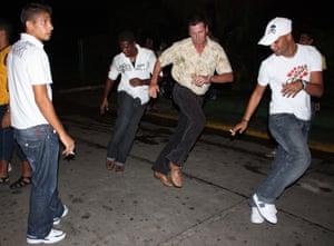 Locals dance on the street in Matanzas, Cuba.