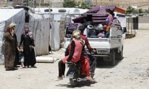 Syrian refugees abandon a camp in the north-eastern town of Arsal as Lebanon's planned demolition of concrete shelters could make at least 15,000 children homeless, aid groups warned