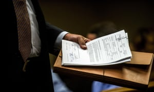 Special agent Jeff Seipenko walks out of the courtroom with signed paperwork in hand after a judge authorized charges on 14 June 2017 in Flint, Michigan for Nick Lyon in relation to the water crisis.