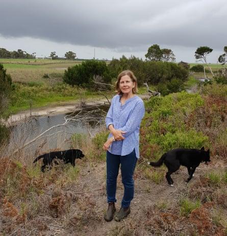Elizabeth Balderstone stands next to Warrigal Creek on her farm in Victoria