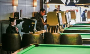 Chicago, IllinoisVoters use both electronic and paper ballots to cast their votes next to a row of pool tables at Pressure Billiards and Cafe
