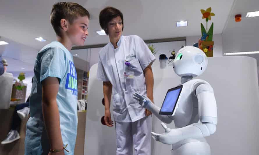 Softbank Robotics' Pepper with a nurse and a boy