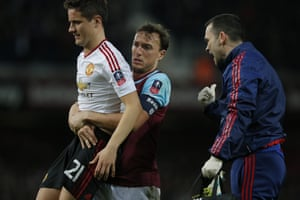 Mark Noble gives Ander Herrera a hand getting off the pitch