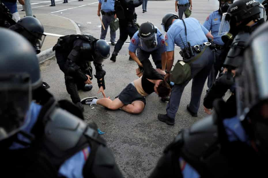 Police in riot gear detain a protester in Raleigh, North Carolina, during nationwide protests following the death of George Floyd.