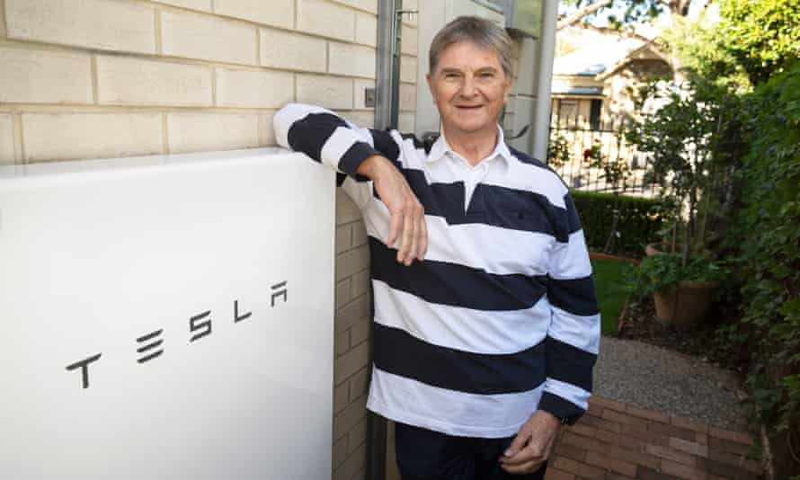 Alan Hedges with his Tesla Powerwall battery at his home in Adelaide.