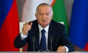 Uzbek President Islam Karimov gestures while speaking to the media