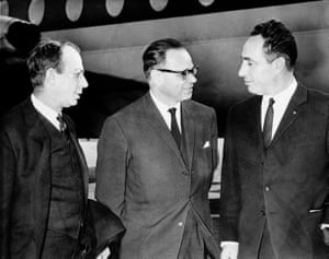Peres with two other men, all in dark suits