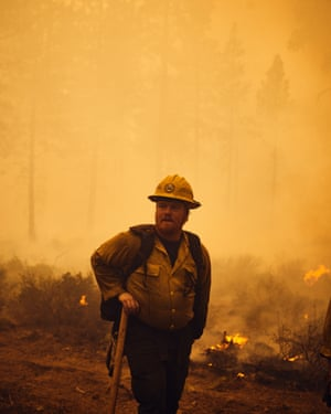 A firefighter takes a breather between duties after a prescribed burn outside Redmond