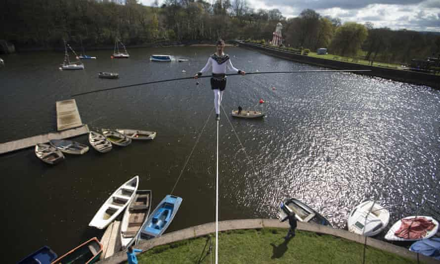 High wire escapade ... Christopher Bullzini recreates the 100ft high wire walk originally performed by Carlos Trower in 1864 and 1878 at Rudyard Lake in Staffordshire.